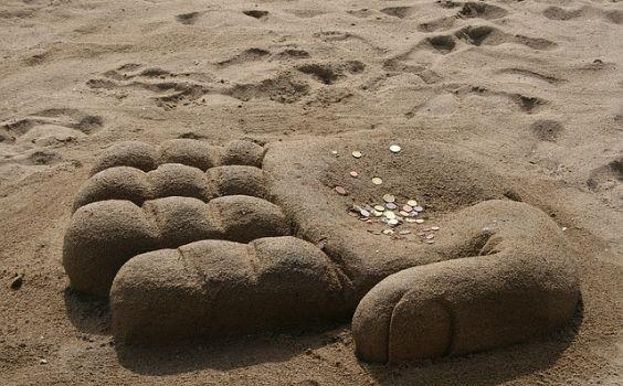 hand strand geld sand l